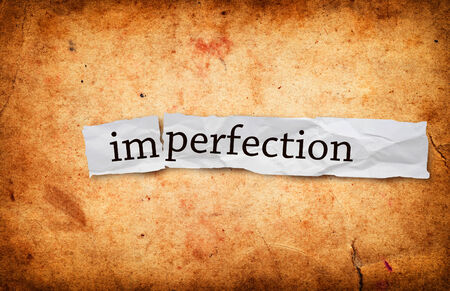 imperfection: Imperfection title on old grunge paper