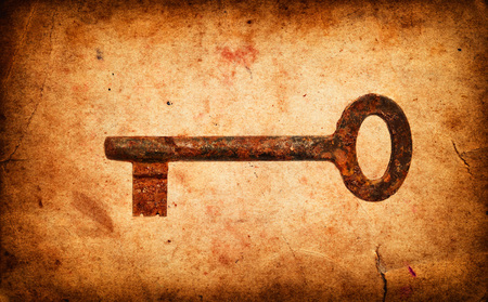 antique key: Old key on Vintage grunge pape background Stock Photo