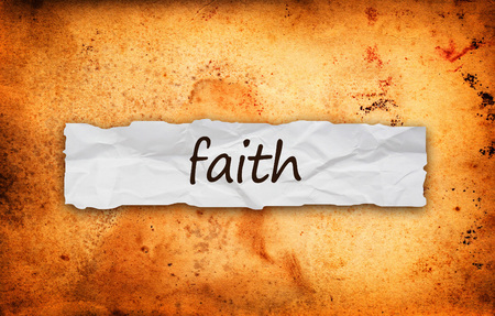 credence: Faith title on piece of crumpled old  paper
