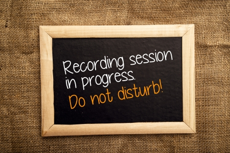 Recording sessiion in progress. Do not disturb note on black message board photo