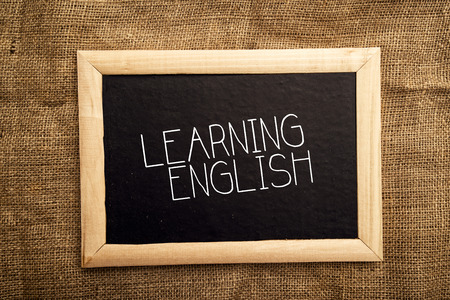 lingua: Learning english note on black message board