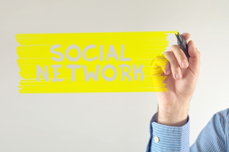 marker pen: Social network concept. Businessman writting note with marker pen.
