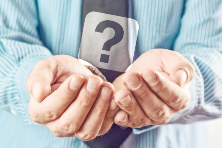 hands cupped: Businessman holding question mark. Businessman begging for answers with his cupped hands.
