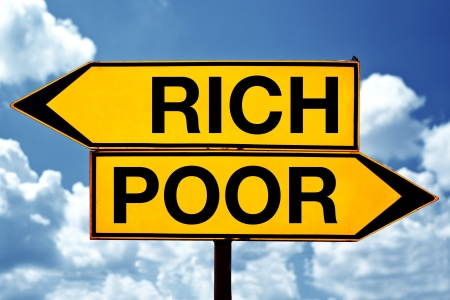 rich or poor, opposite signs. Two opposite signs against blue sky background. photo