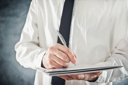 Businessman writing notes or signing document  Close up image with selective focus  Business situation  Stock Photo - 25183658