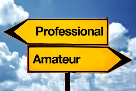Professional or amateur opposite signs Two opposite road signs against blue sky background