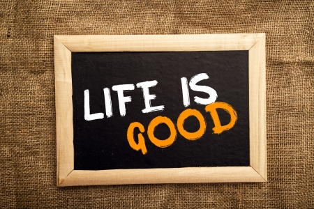good life: Life is good, positive message on black board Stock Photo