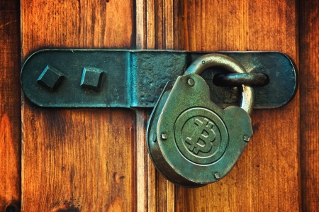 net trade: Bitcoin currency symbol on old metal padlock, safety concept