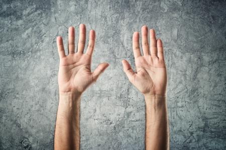 surrender: Caucasian male open hands raised as surrender gesture on grunge background
