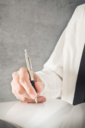 Businessman writing notes or signing document  Close up image with selective focus  Business situation  Stock Photo - 25284574