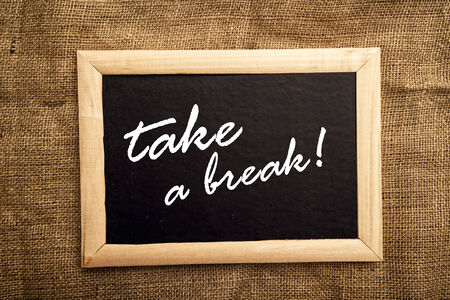 Take a break note on black message board photo