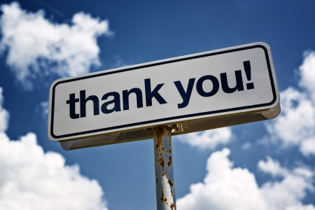 thankful: Thank you street sign against blue sky with clouds Stock Photo