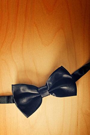 jazzbow: Black Black bow tie on wooden background