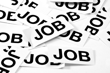 seeker: Job offer. Printed paper notes with the word Job in black ink