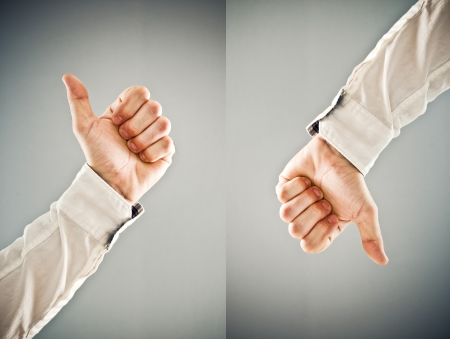 authorize: Businessman showing thumb down and thumb up symbol. Approval and disapproval concept.