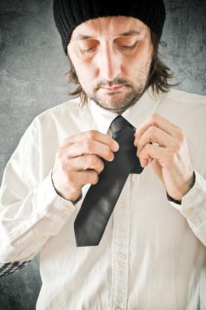 adjustment: Businessman tying necktie. Man correcting tie, close up with selective focus.