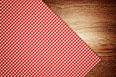 Table cloth, kitchen napkin on wooden table as background photo