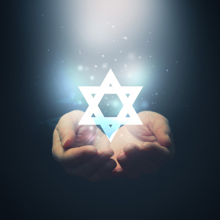 jewish people: Female hands opening to light and David