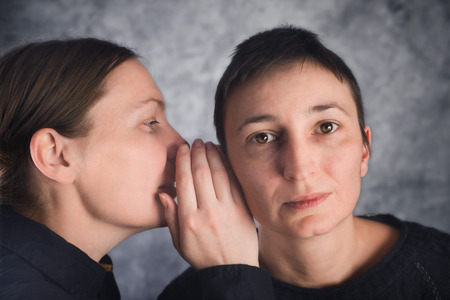 hearsay: Tqo women gossiping, telling secrets or hearsay stories to one another