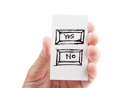 Extended hand holding an business card with YES and NO over white background photo