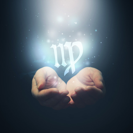 foretelling: Female hands opening to light and holding zodiac sign for Virgo  Horoscope symbols  Selective focus