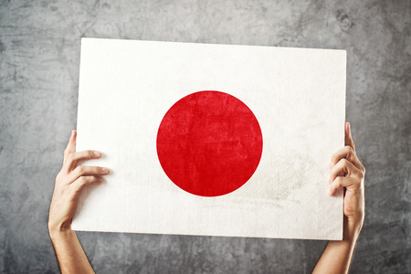 foreign land: Japan flag  Man holding banner with Japanese Flag  Supporting national team, patriotism concept