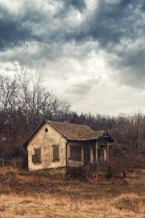 Old abandoned house. Crumbling old house in rural field in North Serbia.