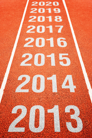 Continous Year Number on athletics running track. Happy new year. Running fast towards New Year. photo