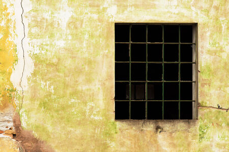 Large old window with broken panes on old cracked wall Stock Photo - 26136167