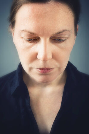 heartbreak issues: Close up portrait of sad woman with selective focus