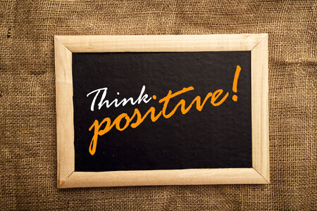 Think positive, motivational messsage on blackbaord. photo