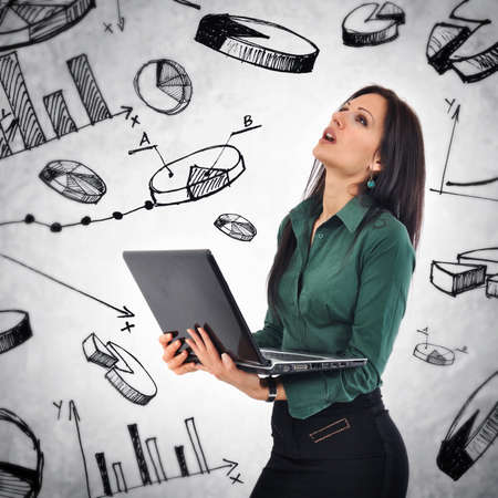 Businesswoman with laptop computer in stresfull situation analyzing infographic elements photo