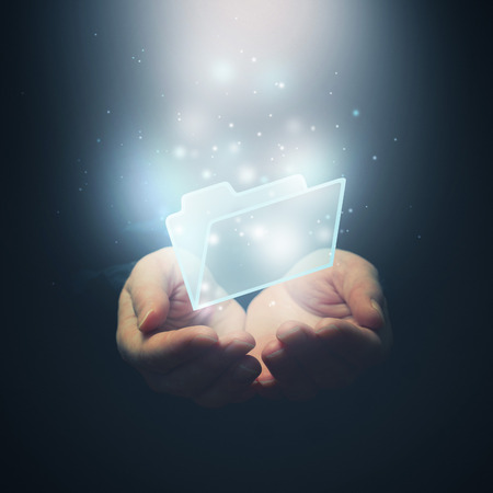 Open hands with file document file folder. File download concept. Selective focus. photo