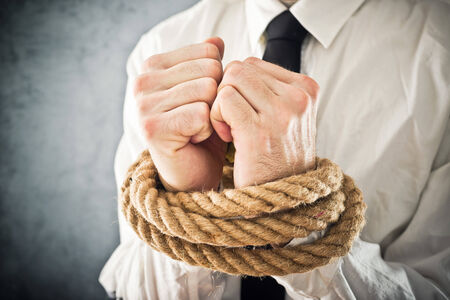 powerless: Businessman with hands tied in ropes. Business problems and difficulties, obstructions and limits in work.
