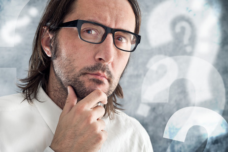 questioning: Businessman thinking and questioning. Stock Photo