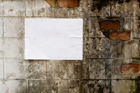 broadside: Blank white poster on grunge wall with copy space for your text or design.