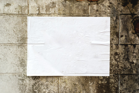 poster wall: Blank white poster on grunge wall with copy space for your text or design.
