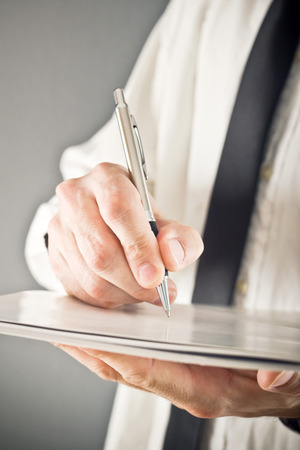 Businessman writing notes or signing document. Close up image with selective focus. Business situation. Stock Photo - 26719307