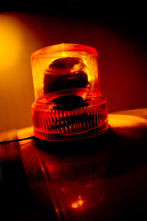rotating: Orange flashing and rotating light on top of a support and services vehicle Stock Photo