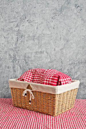 breadloaf: Bread in wicker basket covered with rag on kitchen table with copy space