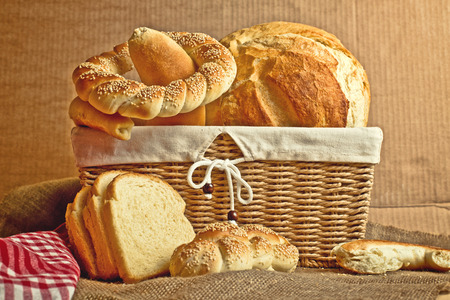 breadloaf: Delicious bread and rolls in wicker basket on kitchen table