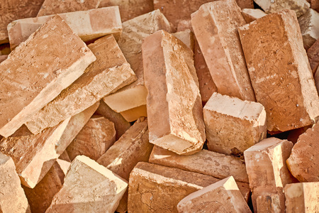 costruction: Pile of bricks  Costruction clay bricks on a heap  Stock Photo