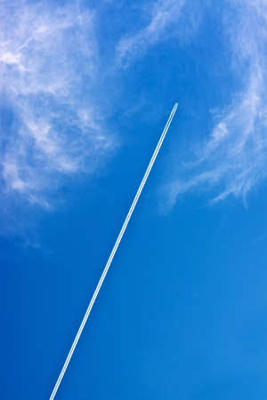 vapour: Airplane and vapour trail in blue sky.