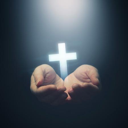 hand of god: Open hands holding cross, symbol of Christian faith