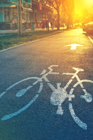 bicycle lane: Bicycle lane mark on the street in sunset Stock Photo