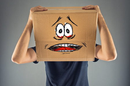 Man with cardboard box on his head and terrified look skethed. terrified; frozen; scared man.
