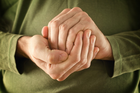 subjective: Man is hidding something in his cupped hands. Secrecy concept. Stock Photo