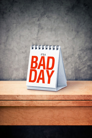 cursed: Its a bad day printed on desk calendar at office table. Misfortune concept.