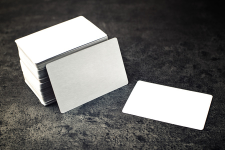 Business cards with rounded corners. Stack of blank horizontal business cards propped up another with copy space for your design. Please, browse my portfolio for more stacked blank business cards images. Stock Photo