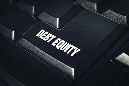 Debt equity on black computer keyboard. banking concept. photo